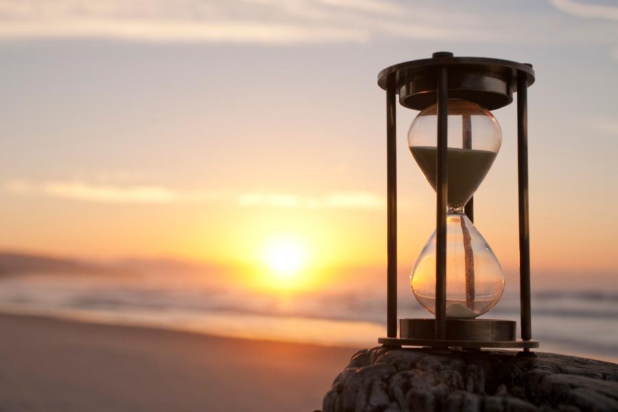 hourglass on a sunset beach